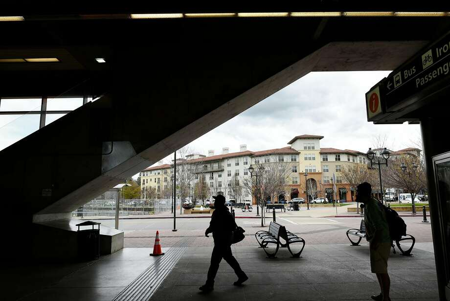 The Avalon Walnut Creek Apartments are seen in the background as people walk through the Pleasant Hill BART Station/Contra Costa Centre in Walnut Creek. Photo: Michael Short, Special To The Chronicle