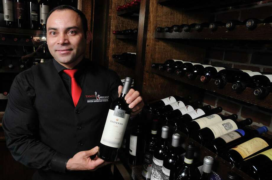 Tango & Malbec sommelier Enrique Varela has a great number of Argentinean malbecs he can recommend to diners. One of his current favorites is the 2014 Toso Alta Barrancas Vineyard Malbec. Photo: Dave Rossman, Freelance / Dave Rossman
