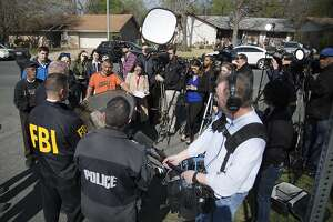 Authorities speak to the media after multiple explosions in Austin on Monday, March 12, 2018. Police are responding to another explosion Monday, that badly injured a woman, hours after a package bomb killed a teenager and wounded a woman in a different part of the city. (Ricardo B. Brazziell/Austin American-Statesman via AP)