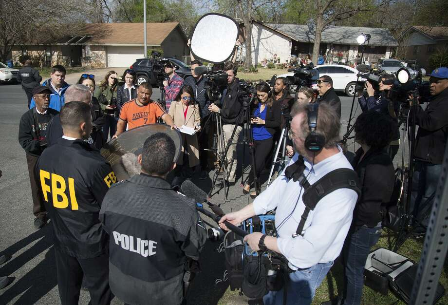 Authorities speak to the media after multiple explosions in Austin on Monday, March 12, 2018. Police are responding to another explosion Monday, that badly injured a woman, hours after a package bomb killed a teenager and wounded a woman in a different part of the city. (Ricardo B. Brazziell/Austin American-Statesman via AP) Photo: Ricardo B. Brazziell, MBO / Associated Press / RICARDO B. BRAZZIELL / AMERICAN-STATESMAN