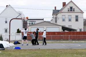 Friends, from left to right, Noah Bagnardi, John Macri, Darren Lee, and Chris Place play basketball in Clinton Park on Monday, March 12, 2018, in Watervliet, N.Y.     (Paul Buckowski/Times Union)