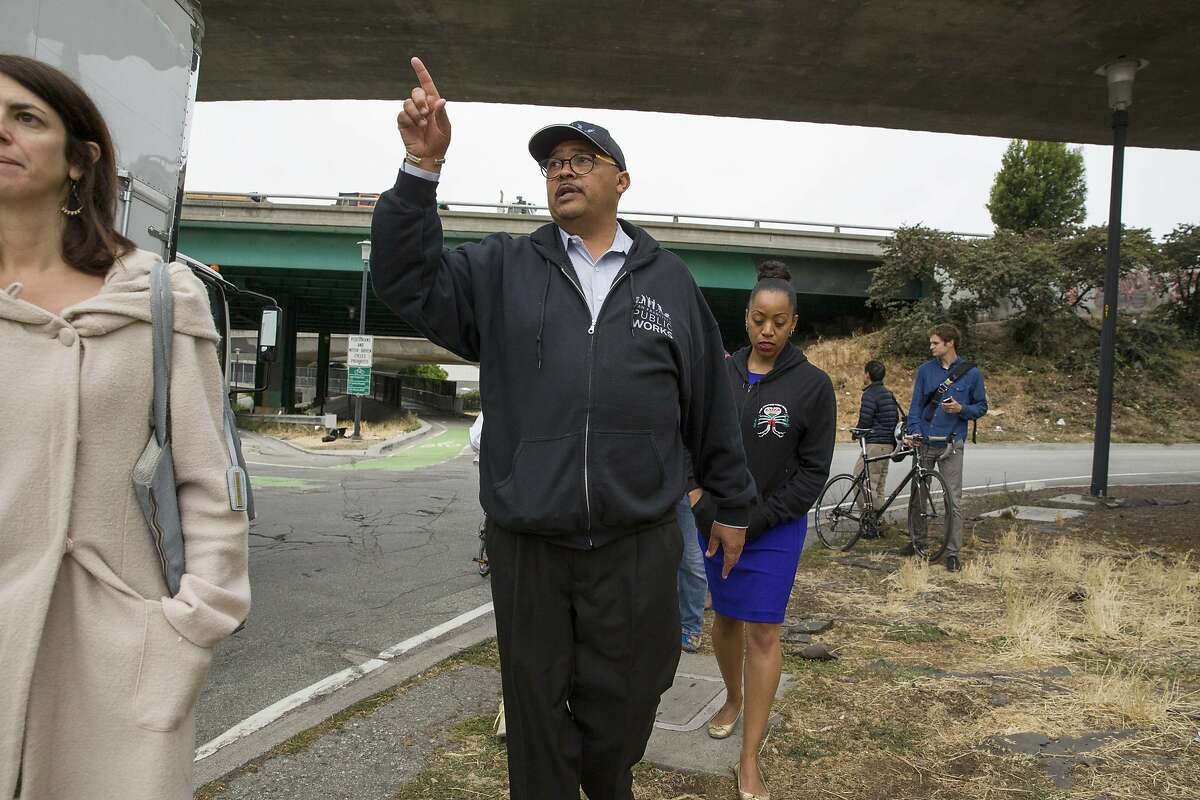 Public Works director Mohammed Nuru (center) tours the area near Cesar Chavez Street and Potrero Avenue with district supervisors Hillary Ronen (left) and Malia Cohen on Wednesday, July 26, 2017, in San Francisco, Calif.