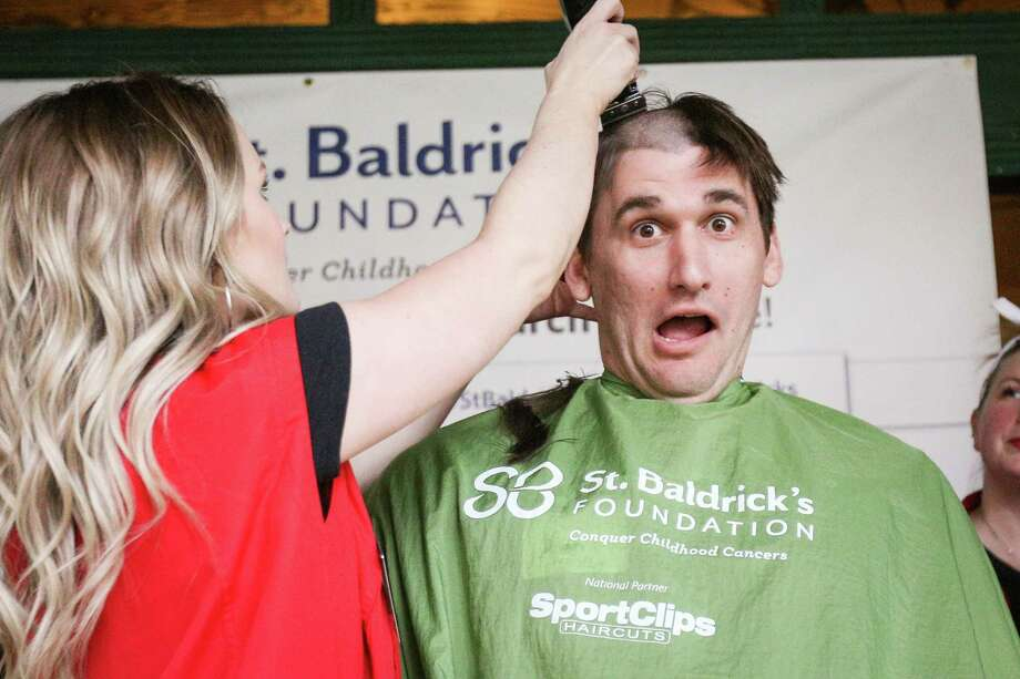 The Woodlands resident Alan Gaska reacts as his head is shaved by Sports Clipsé• Courtney Castro during the St. Baldrick's Day fundraising event on Sunday, March 11, 2018, at The Goose's Acre in The Woodlands. Photo: Michael Minasi, Staff Photographer / © 2018 Houston Chronicle