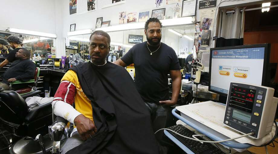 CORRECTS CITY TO INGLEWOOD FROM LOS ANGELES - In this Sunday, March 11, 2018, photo, Barber Eric Muhammad, owner of A New You Barbershop measures the blood pressure of customer Marc M. Sims in Inglewood, Calif. Black male customers at dozens of Los Angeles area barbershops reduced one of their biggest health risks through a novel project that paired barbers and pharmacists to test and treat customers. (AP Photo/Damian Dovarganes) Photo: Damian Dovarganes, Associated Press