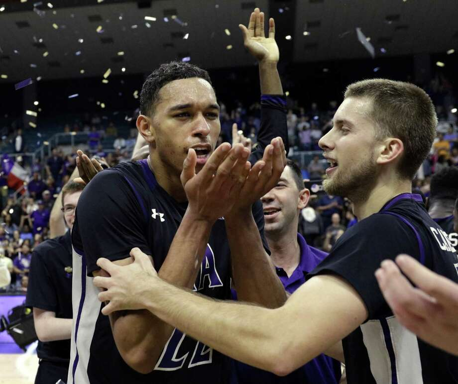 Stephen F. Austin forward TJ Holyfield (22) blows away falling confetti as John Comeaux (10) reaches for a hug after defeating Southeastern Louisiana after an NCAA college basketball game in the Southland Conference's Men's Basketball Tournament Championship Saturday, March 10, 2018, in Houston. (AP Photo/Michael Wyke) Photo: Michael Wyke, FRE / Associated Press / © Associated Press 2017