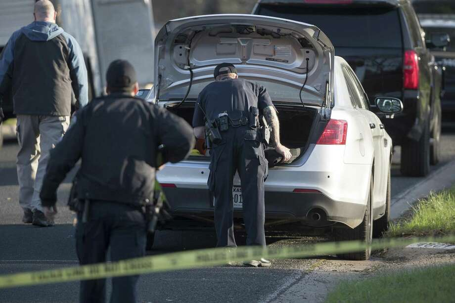 Authorities investigate the scene in East Austin after a teenager was killed and a woman was injured in the second Austin package explosion in the past two weeks on Monday, March 12, 2018. (Ricardo B. Brazziell/Austin American-Statesman/TNS) Photo: RICARDO B. BRAZZIELL, MBR / TNS / Austin American-Statesman