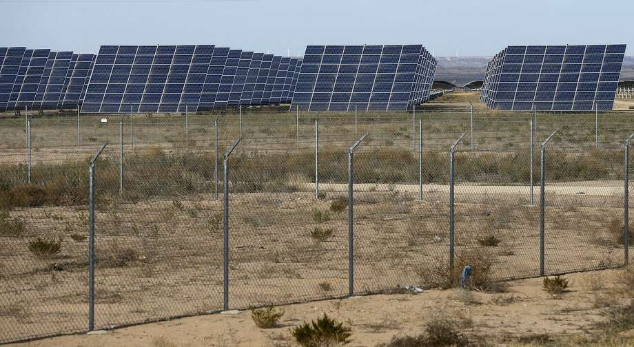 These solar panels are part of OCI Solar Power's Alamo 6 field. The company announced Monday that it had sold its under construction Project Ivory, a 50 megawatt AC solar project in West Texas. Photo: John Davenport /San Antonio Express-News / ©John Davenport/San Antonio Express-News