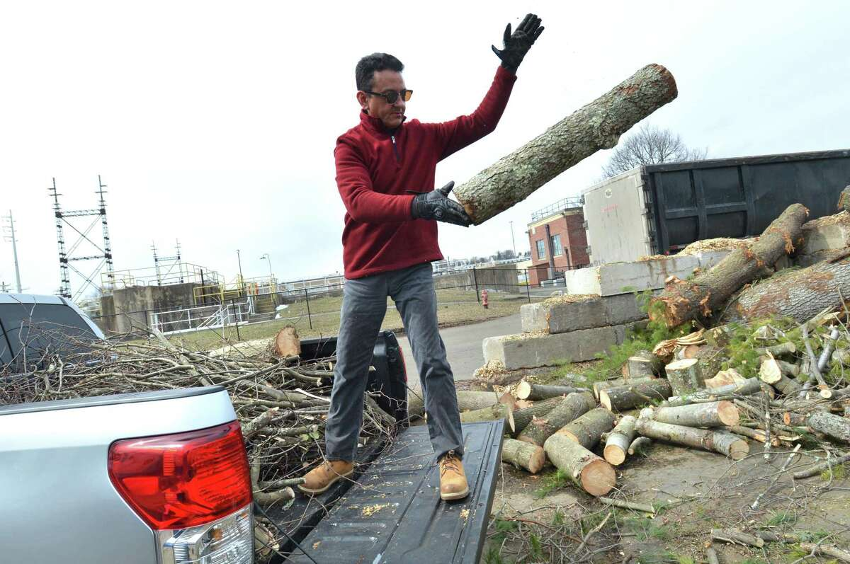 Gino Linaldi adds more storm debris from his house to the pile of wood at the yard waste area at The Department of Public Works on Monday March 12, 2018 in Norwalk Conn.