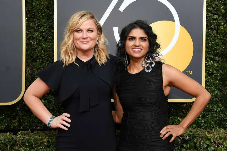 BEVERLY HILLS, CA - JANUARY 07:  75th ANNUAL GOLDEN GLOBE AWARDS -- Pictured: (l-r) Actor Amy Poehler and Activist Saru Jayaraman arrive to the 75th Annual Golden Globe Awards held at the Beverly Hilton Hotel on January 7, 2018.  (Photo by Kevork Djansezian/NBC/NBCU Photo Bank via Getty Images)