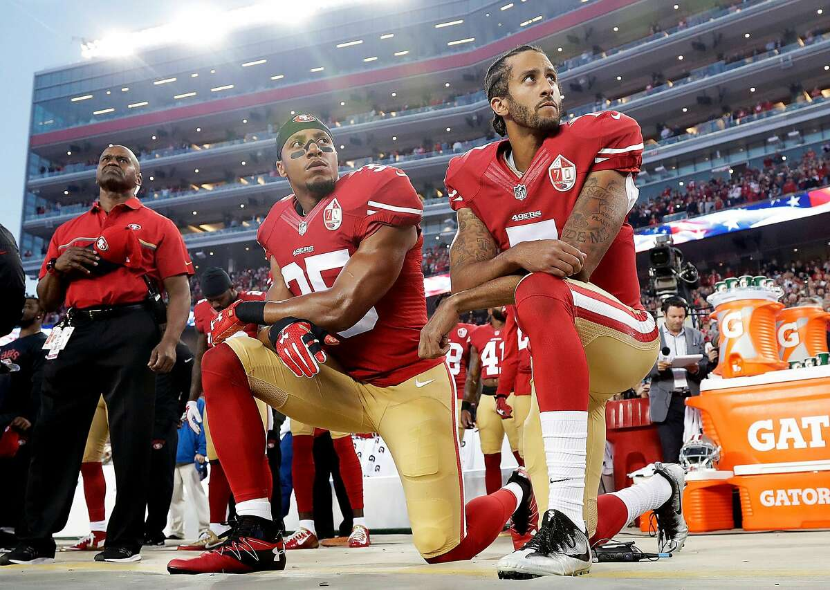In this Monday, Sept. 12, 2016, file photo, San Francisco 49ers safety Eric Reid (35) and quarterback Colin Kaepernick (7) kneel during the national anthem before an NFL football game against the Los Angeles Rams in Santa Clara.