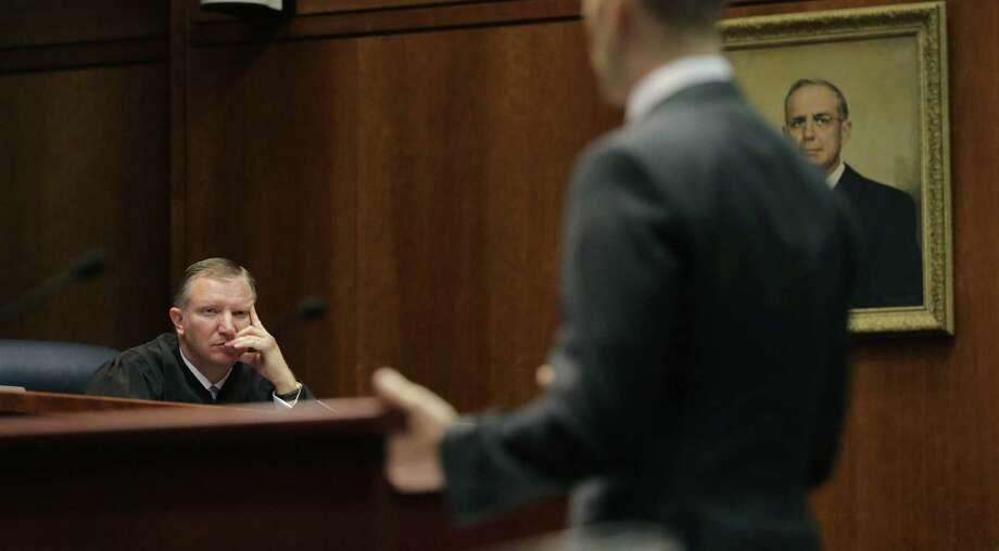 Texas Supreme Court Justice Jeff Brown listens to oral arguments in Texas' latest school finance case in 2015. That case resulted in a ruling that the way the state was financing schools was deeply flawed but constitutional. Two years after the ruling, the Legislature hasn't fixed those flaws. Photo: File Photo /Associated Press / AP