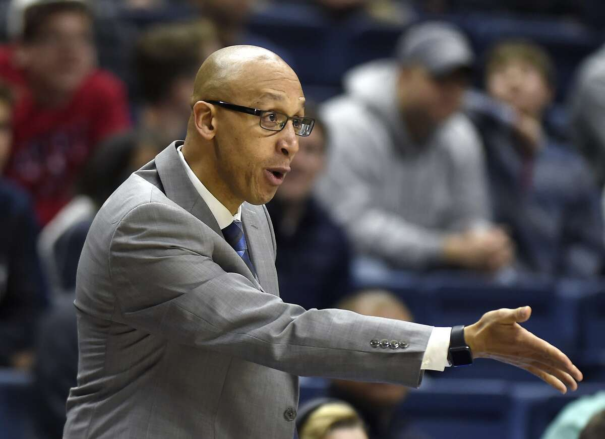 Connecticut Huskies associate head coach Raphael Chillious speaks to a player during a game against Memphis on Sunday, Feb. 25, 2018 at Gampel Pavilion in Storrs, Conn. Memphis won the game, 83-79. (Brad Horrigan/Hartford Courant/TNS)