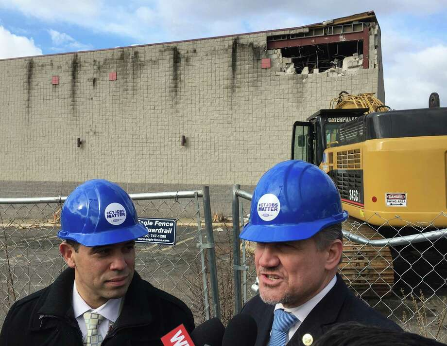 Rodney Butler, left, the Mashantucket Pequot chairman, and Kevin Brown, the Mohegan chairman, at the site of the old Showcase Cinemas in East Windsor on Monday, March 5, 2018.  The Mashantucket Pequot and Mohegan tribes plan a casino at the site. Photo: Dan Haar / Hearst Connecticut Media / Connecticut Post