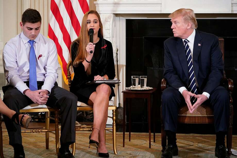 In this file photo taken on February 21, 2018, President Donald Trump watches as Julia Cordover, Parkland student body president, speaks during a listening session on gun violence in the State Dining Room of the White House. President Trump stood accused March 12, 2018 of caving in to the US gun lobby one month after the Florida school shooting. Photo: MANDEL NGAN, AFP/Getty Images
