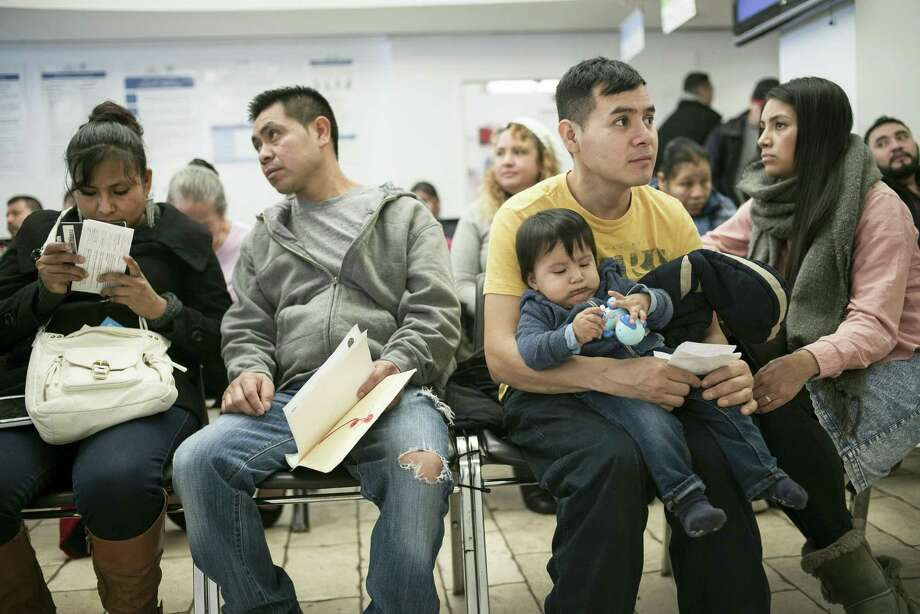 People wait at the Mexican Consulate in New York, Feb. 17, 2017. Mexican consulates across the country have been flooded with calls and visits from Mexican nationals worried about President Donald Trump's promise to crack down on immigrants living in the U.S. illegally. Photo: TODD HEISLER, STF / NYT / NYTNS