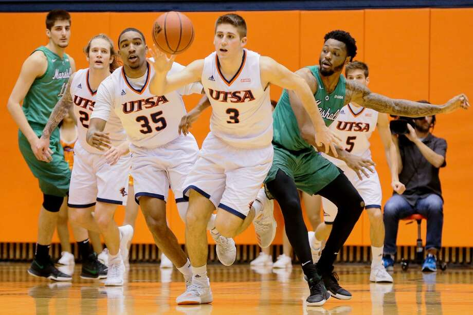 UTSA's Byron Frohnen (center) omes up with a steal during the second half of their men's basketball game with Marshall at the Convocation Center on Thursday, Feb. 1, 2018.  MARVIN PFEIFFER/mpfeiffer@express-news.net Photo: Marvin Pfeiffer, Staff / San Antonio Express-News / Express-News 2018