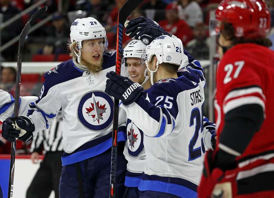 Winnipeg's Patrik Laine celebrates one of his 40 goals with teammates Nikolaj Ehlers (center) and Paul Stastny (25). Photo: Karl B DeBlaker, Associated Press