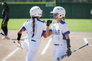 New Caney's Kaelin Morkisch (1) and Fatima Aranda (3) celebrate a run during the softball game against Humble on Monday, March 12, 2018, in New Caney. (Michael Minasi / Houston Chronicle)