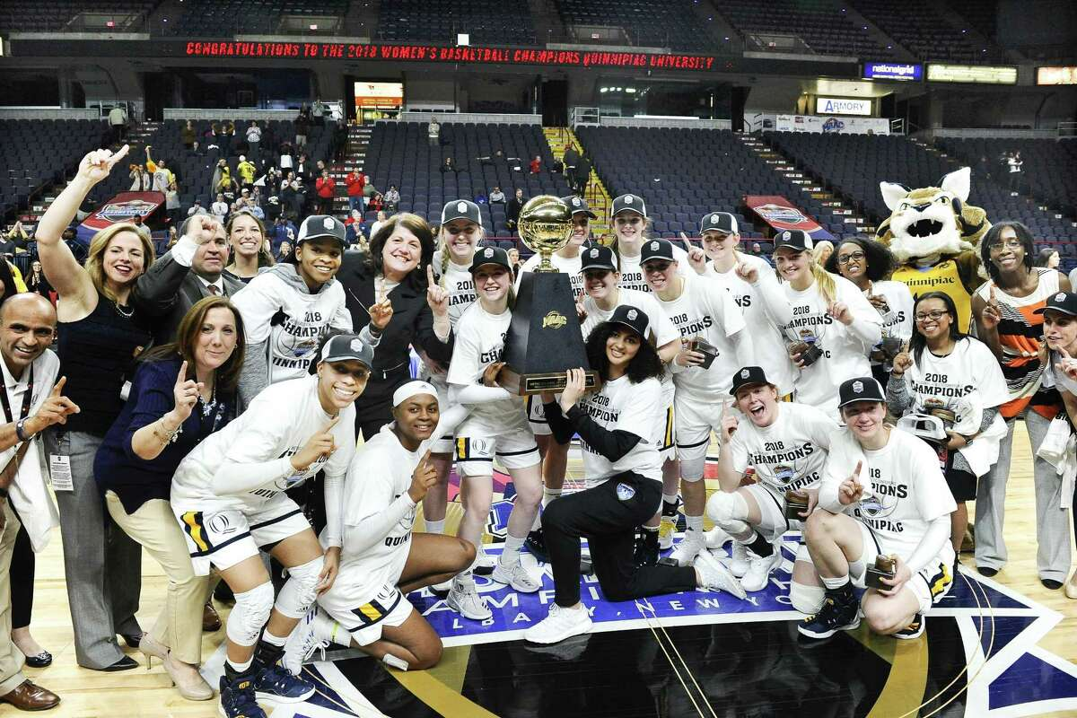 Quinnipiac players pose for a photograph after winning the MAAC championship on March 5.
