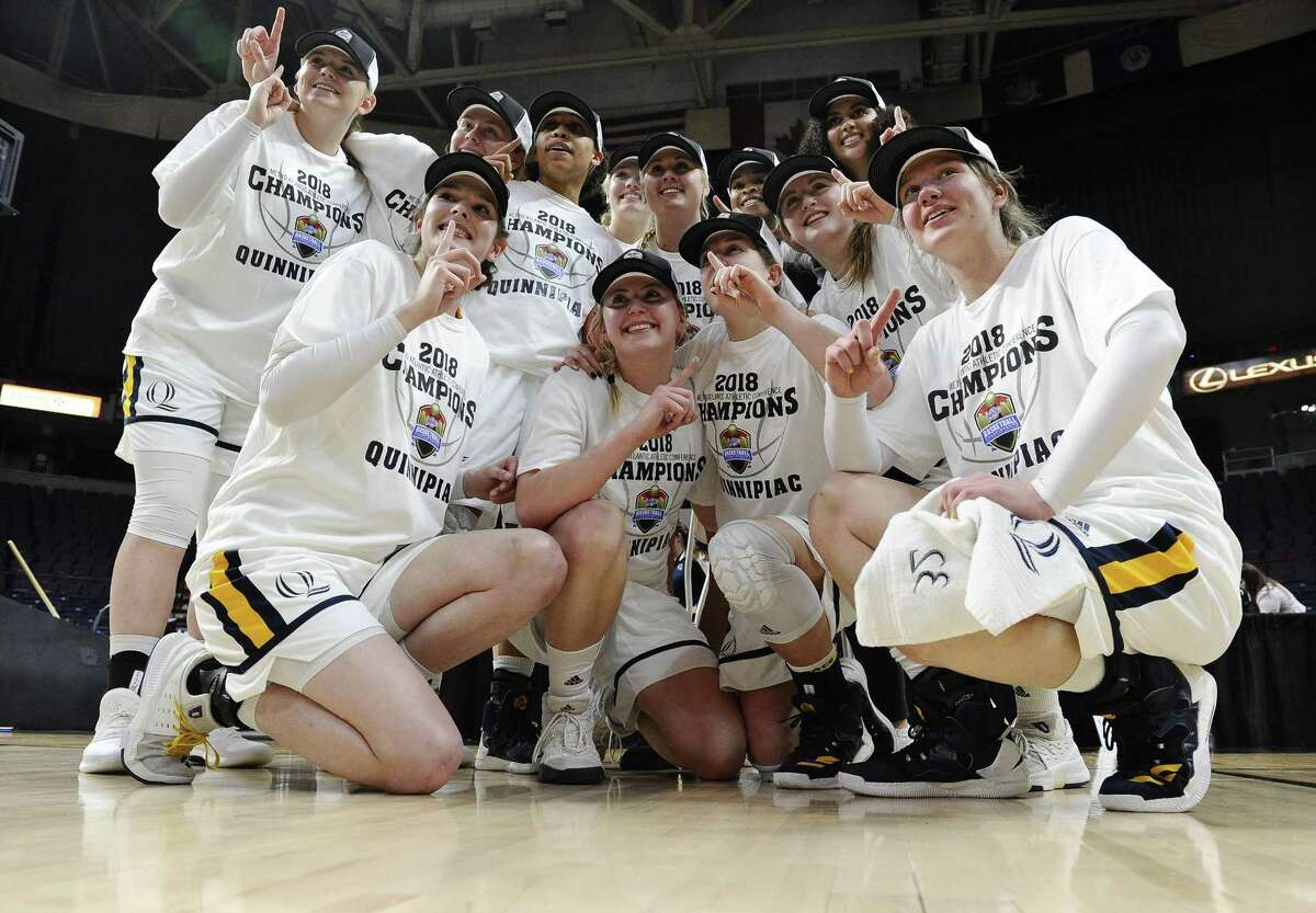 Quinnipiac players celebrate their win over Marist in the MAAC championship game on March 5.