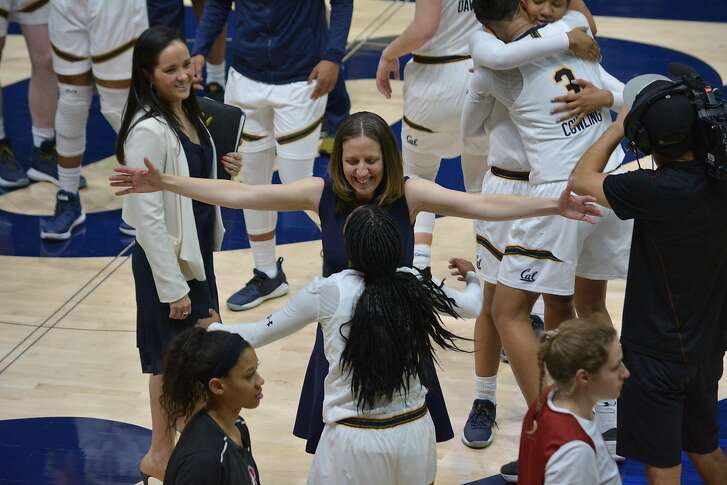 Lindsay Gottlieb, arms extended, congratulates Asha Thomas after the Golden Bears defeated Stanford in February.
