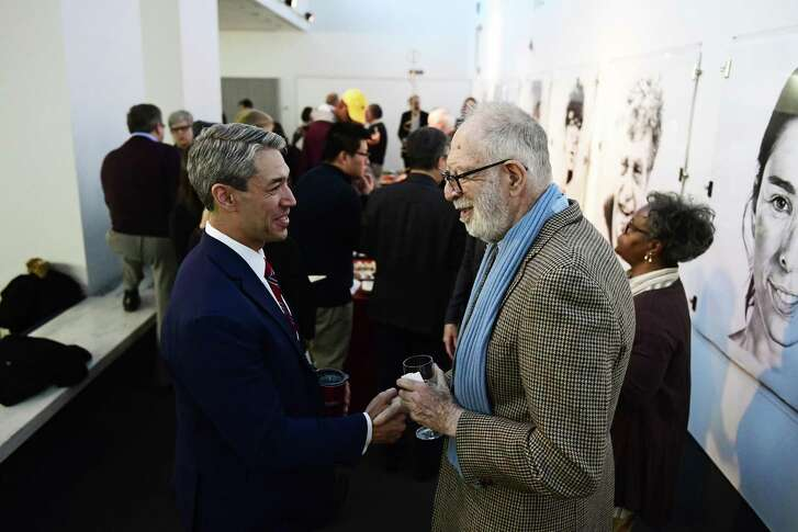 Ron Nirenberg shakes hands with Monroe E. Price during a social reception before his speech Monday, March 12, 2018 in Philadelphia, Pa. The San Antonio Mayor presented the 2018 George Gerbner Lecture in Communication ÒBe a Better Neighbor: The Education of a Mayor,Ó at the Annenberg School for Communication at the University of Pennsylvania. (Corey Perrine/For the San Antonio Express-News)