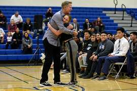 Warriors head coach Steve Kerr gives a hug to student Brooke Brown while speaking with students at Newark Memorial High School during a panel discussion on gun violence, in Newark, Calif., on Monday March 12, 2018.