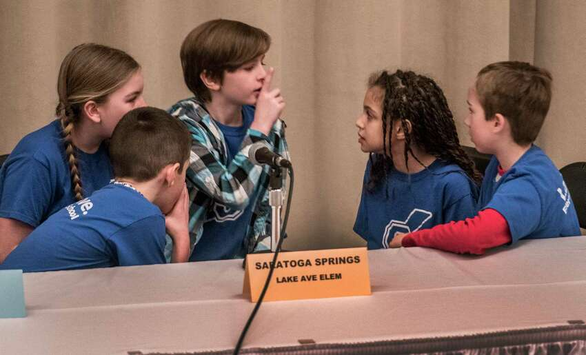 Students from the fourth grade at the Lake Avenue Elementary School during the competition in the Battle of the Books which was held in Palamountain Hall on the Skidmore Campus Monday March 12, 2018 in Saratoga Springs, N.Y. Members of the team which won their first round test are from left to right; Hayden Passaretti, Eleni Hill, Mimi Hrbek, Skarlet Crowley and Weston Perry. (Skip Dickstein/Times Union)