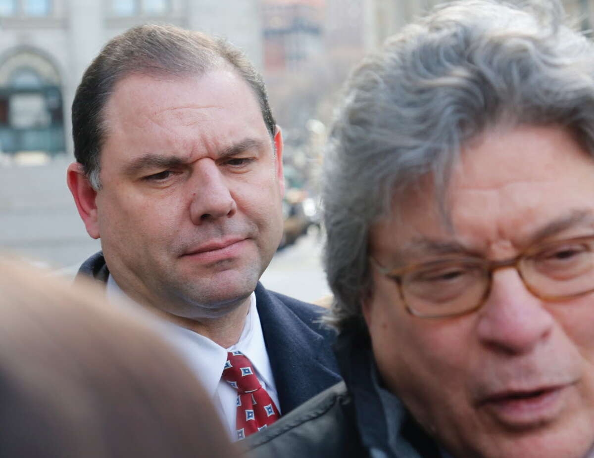 Joseph Percoco, left, former top aide to Gov. Andrew Cuomo accused of bribery, listen as his lawyer Barry Bohrer speaks to reporters after a judge dismissed a jury for the weekend in his trial, Friday March 9, 2018 in New York. (AP Photo/Bebeto Matthews)