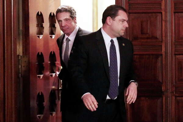 FILE — Joseph Percoco, right, with New York Gov. Andrew Cuomo in Albany, N.Y., Feb. 27, 2013. Testimony in Percoco's federal corruption trial may have tarnished Cuomo's reputation and may complicate any national ambitions the governor has, with a recent poll finding 63 percent saying he should not run for president. (Nathaniel Brooks/The New York Times)