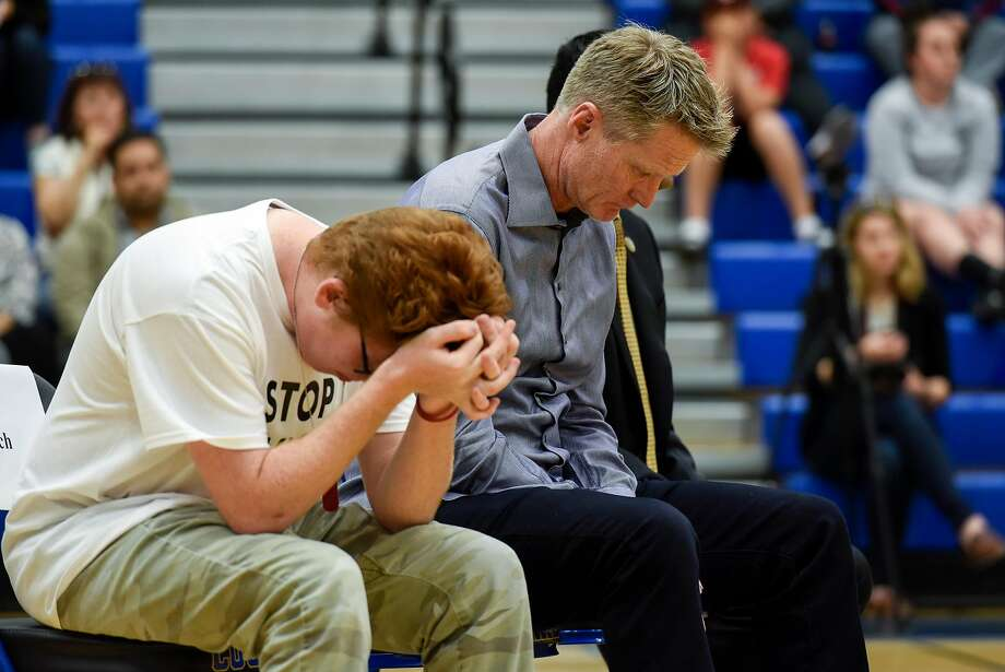 Warriors head coach Steve Kerr (right) and Matt Deitsch, whose sister survived the Parkland, Fla., attack, attend a town hall meeting in Newark. Photo: Michael Short, Special To The Chronicle