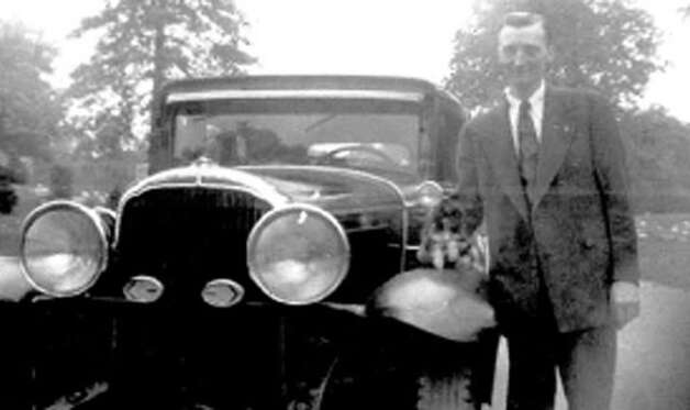 Hans Frederick Hanson looks dapper as he stands by a motorcar. His fate as unknown for years until his nephew noticed a newspaper story about Hanson's upcoming funeral. (Courtesy  Robert Hanson)