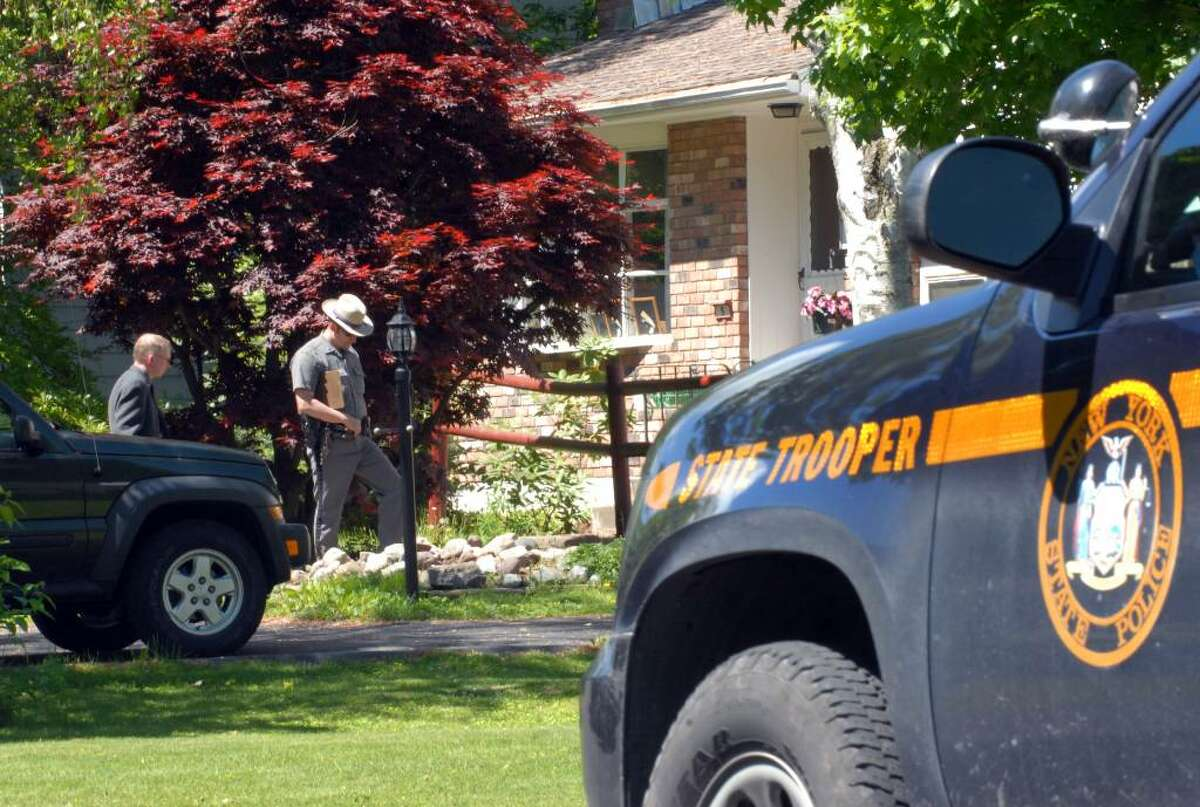 State Police investigate the scene at the home of Gary Veeder, a longtime forensic scientist for the New York State Police, who committed suicide at his home in Voorheesville in 2008. (WILL WALDRON / TIMES UNION )