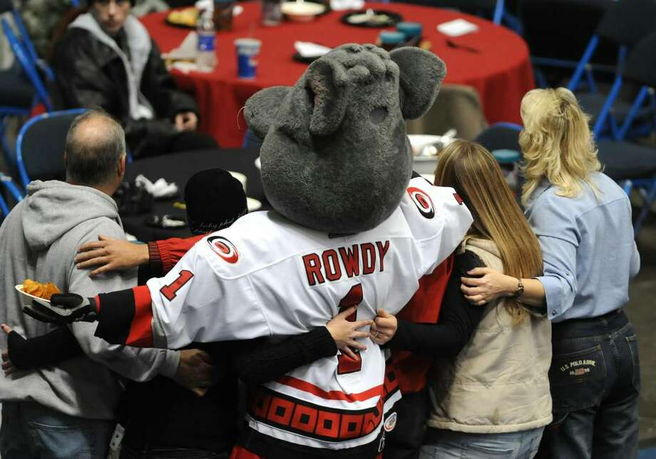 River Rats fans get their photo taken with Rowdy the mascot. Photo: LORI VAN BUREN
