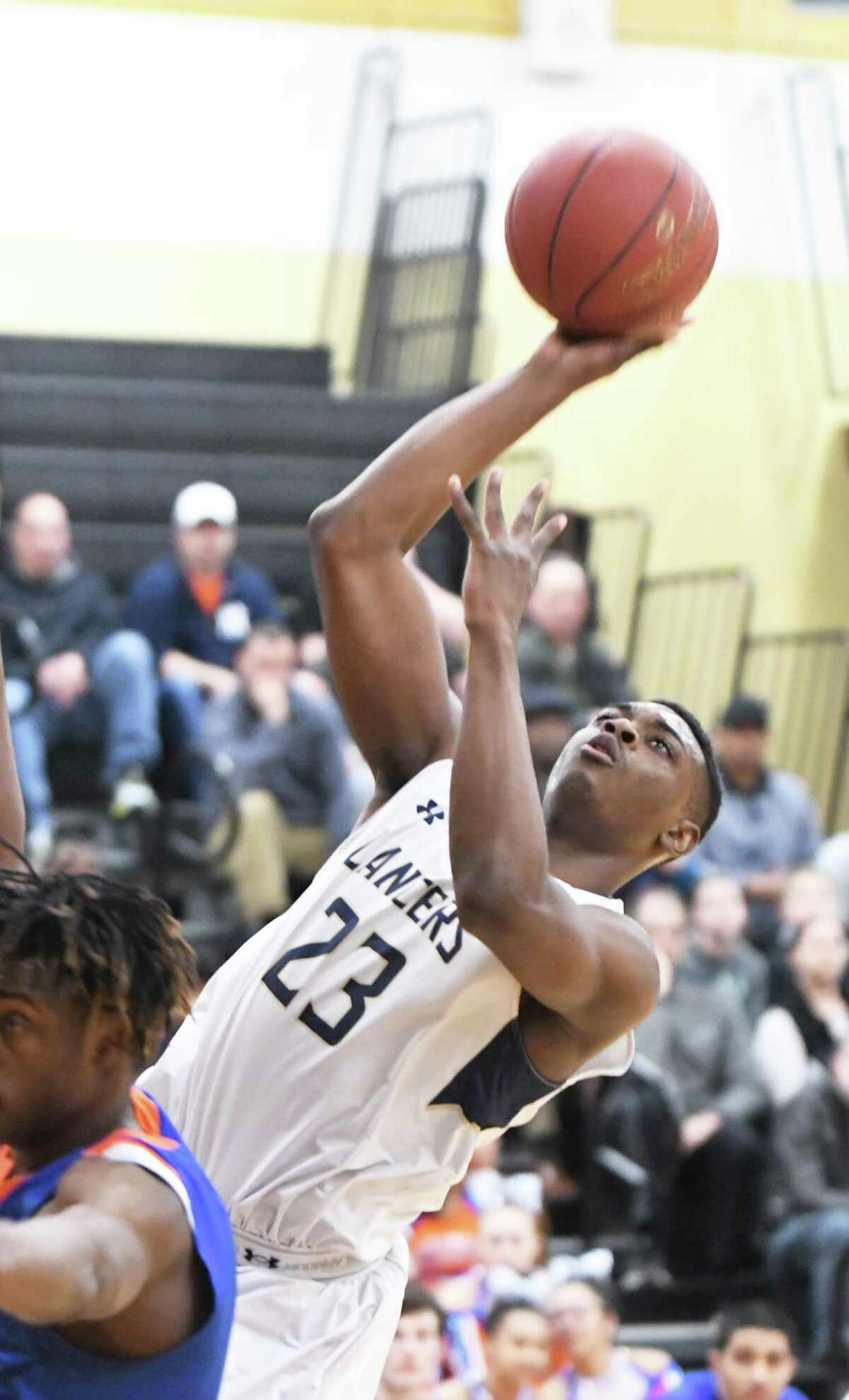 Notre Dame?'s Josh Reaves makes a shot during the Division I boys basketball quarterfinals between Danbury and Notre Dame-Fairfield at Trumbull High, March 12, 2018.