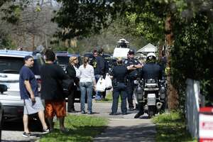 Federal, state and local law enforcement agencies investigate the scene of explosion at the 6700 block of Galindo Street in southeast Austin, Monday, March 12, 2018. An unknown person left a package that exploded when two women at the residence opened it. Earlier in the morning, a teenager was killed in similar fashion at a residence on the 4800 block of Oldfort Hill Drive.
