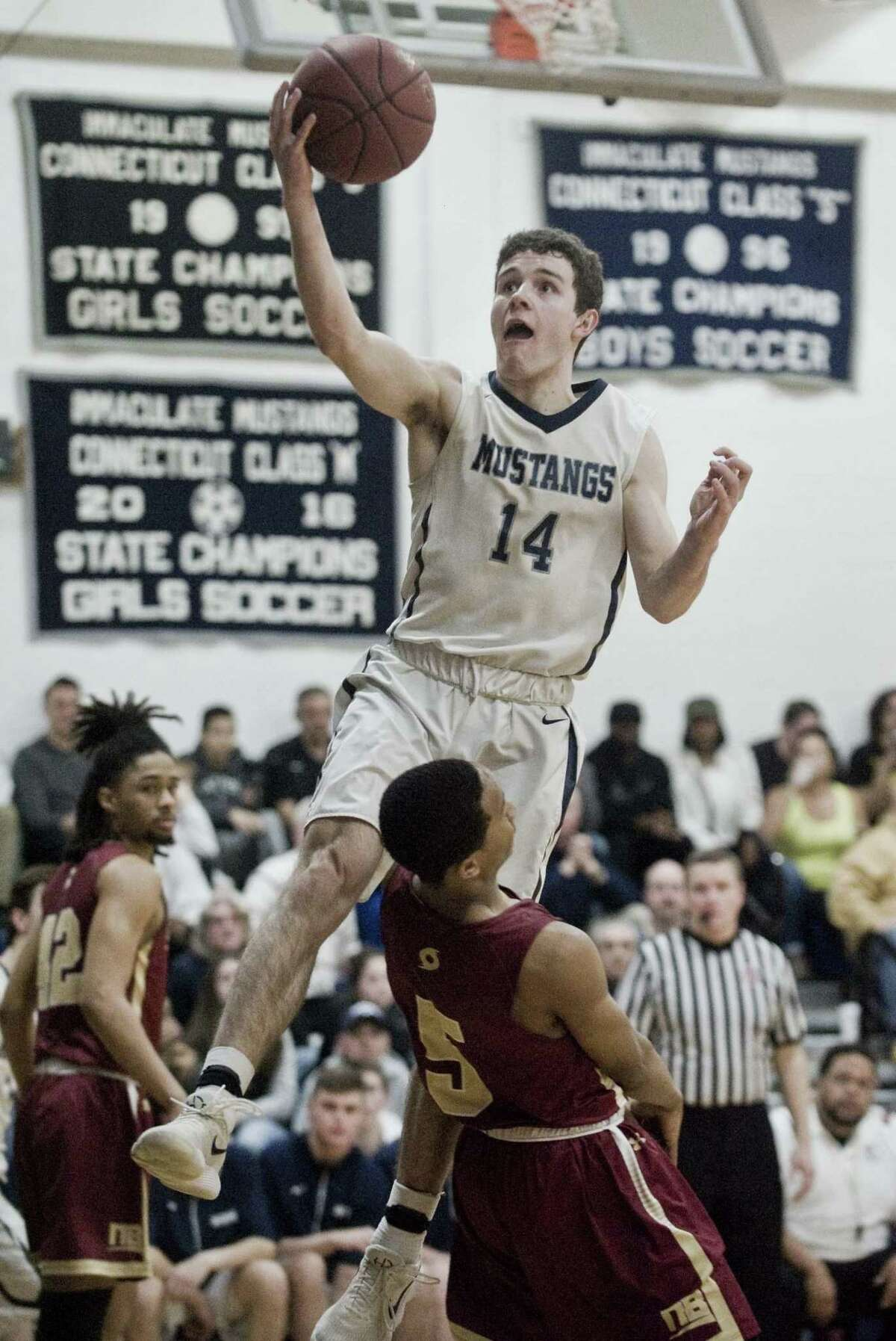 Immaculate High School's Ronan Doherty goes up to the basket in the Division II boys basketball quarterfinals against New Britain High School, played at Immaculate. Monday, March 12, 2018