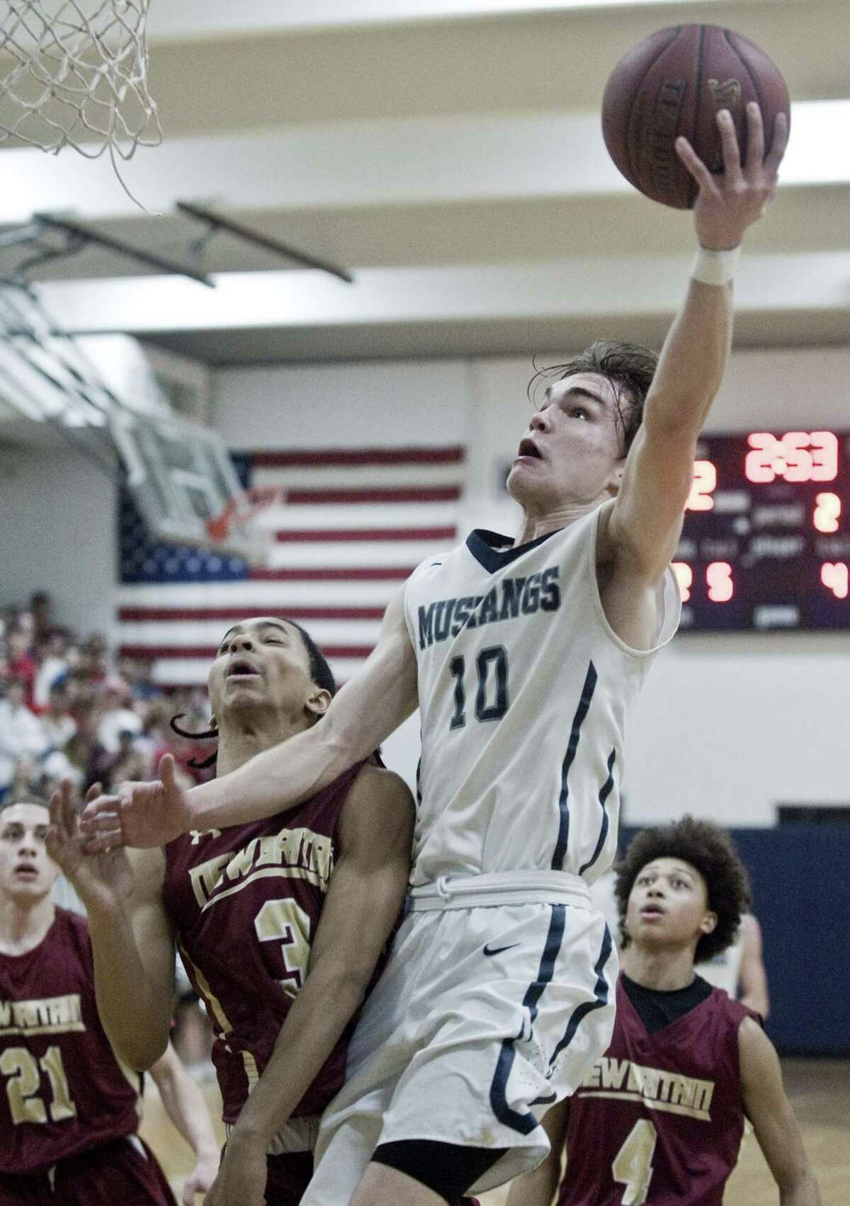 Immaculate High School's Quinn Guth rises for a shot in the Division II boys basketball quarterfinals against New Britain High School, played at Immaculate. Monday, March 12, 2018