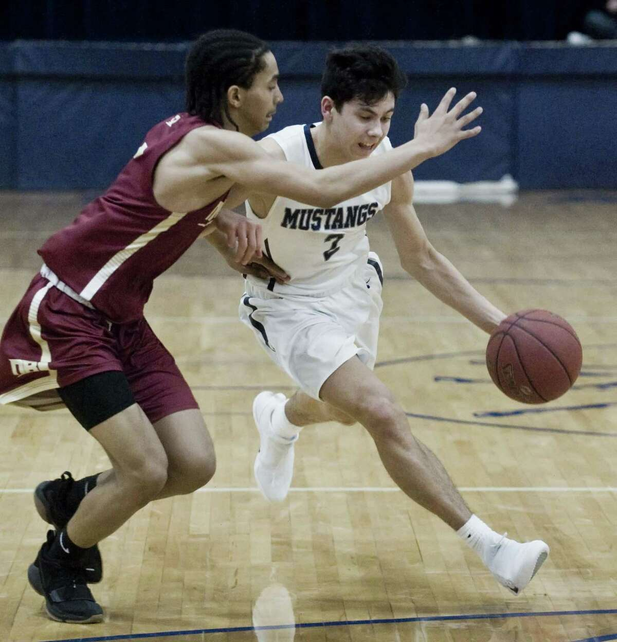 New Britain High School's Isaiah Jenkins guards Immaculate High School's Michael Basile in the Division II boys basketball quarterfinals against New Britain High School, played at Immaculate. Monday, March 12, 2018