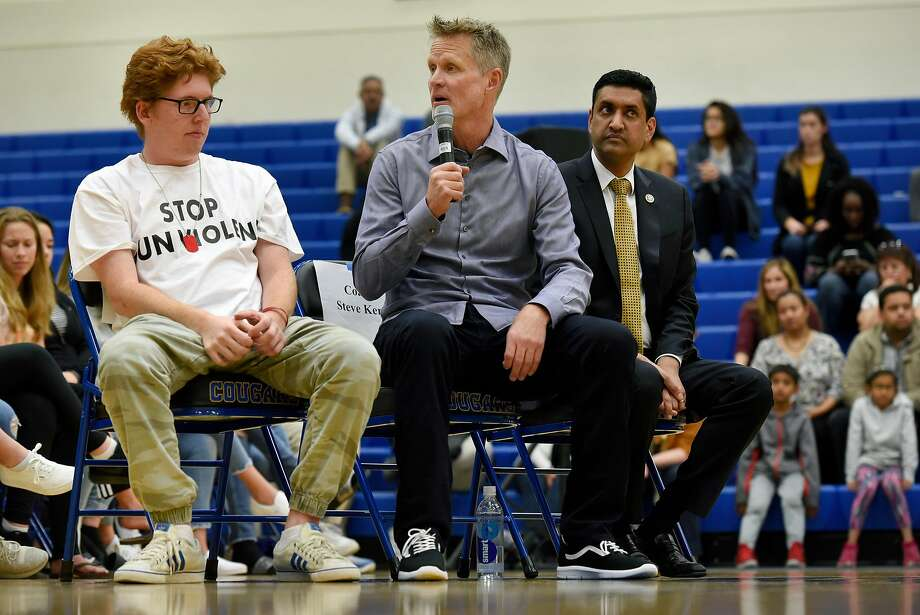 From left, Former Parkland, Florida student and March For Our Lives member Matt Deitsch, Warriors head coach Steve Kerr, and congressman Ro Kahanna speak with students at Newark Memorial High School during a panel discussion on gun violence, in Newark, Calif., on Monday March 12, 2018. Photo: Michael Short, Special To The Chronicle