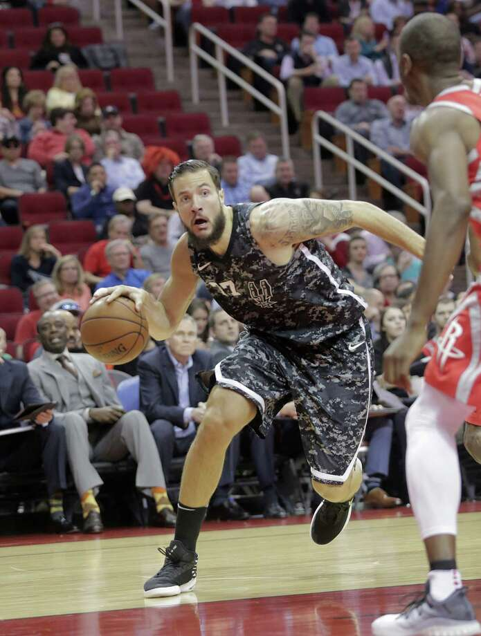 San Antonio Spurs center Joffrey Lauvergne (77) drives to the basket against the Houston Rockets at the Toyota Center on Monday, March 12, 2018, in Houston. Photo: Elizabeth Conley, Houston Chronicle / © 2018 Houston Chronicle
