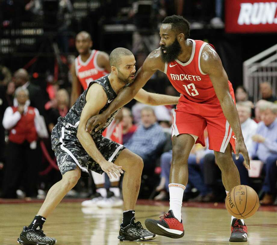HOUSTON, TX - MARCH 12:  James Harden #13 of the Houston Rockets holds off Tony Parker #9 of the San Antonio Spurs at Toyota Center on March 12, 2018 in Houston, Texas. NOTE TO USER: User expressly acknowledges and agrees that, by downloading and or using this photograph, User is consenting to the terms and conditions of the Getty Images License Agreement. Photo: Bob Levey, Getty Images / 2018 Getty Images