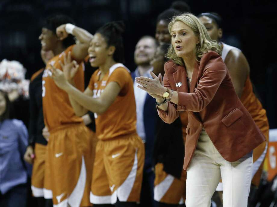 Texas head coach Karen Aston cheers for her team during an NCAA college basketball game against Baylor in the championship game of the women's Big 12 conference tournament in Oklahoma City, Monday, March 5, 2018. (AP Photo/Sue Ogrocki) Photo: Sue Ogrocki, STF / Associated Press / AP2018