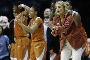 Texas head coach Karen Aston cheers for her team during an NCAA college basketball game against Baylor in the championship game of the women's Big 12 conference tournament in Oklahoma City, Monday, March 5, 2018. (AP Photo/Sue Ogrocki)