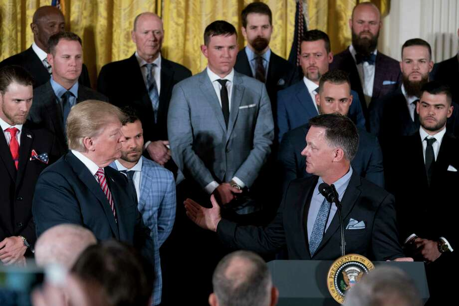 President Donald Trump, left, gave manager A.J. Hinch a turn at his East Room podium during the Astros' visit on Monday. Photo: Andrew Harnik, STF / Copyright 2018 The Associated Press. All rights reserved.