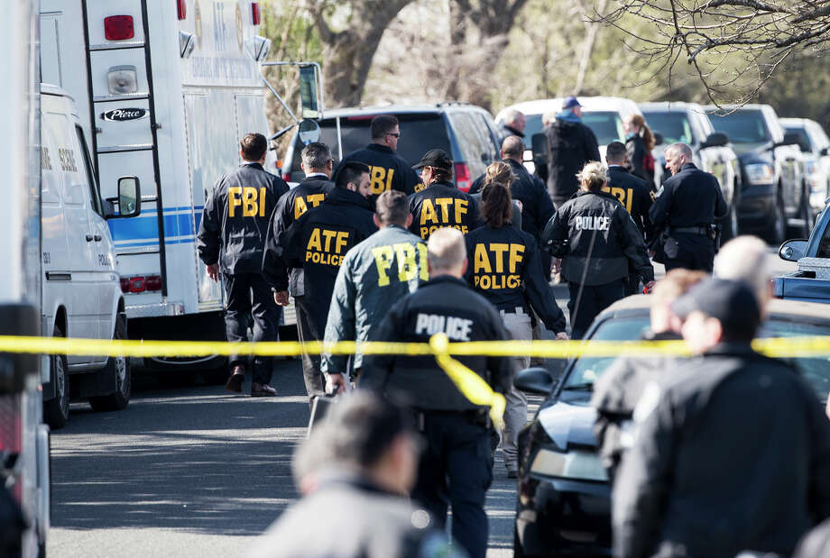 Authorities are investigating the scene after multiple explosions in Austin on Monday, March 12, 2018. Police are responding to another explosion Monday, that badly injured a woman, hours after a package bomb killed a teenager and wounded a woman in a different part of the city. (Ricardo B. Brazziell/Austin American-Statesman via AP) Photo: Ricardo B. Brazziell / RICARDO B. BRAZZIELL / AMERICAN-STATESMAN