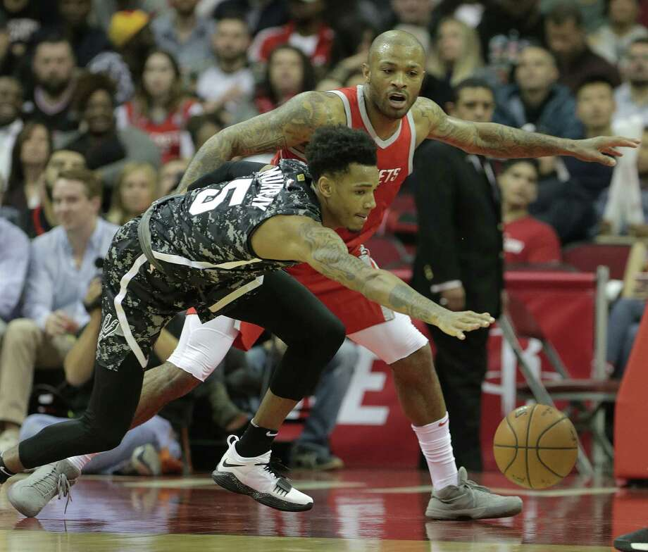 Second-year Spurs guard Dejounte Murray (5) loses control of the ball under Rockets forward P.J. Tucker's pressure. Murray is getting a crash course in the NBA thanks to coach Gregg Popovich. Photo: Elizabeth Conley, Staff / © 2018 Houston Chronicle