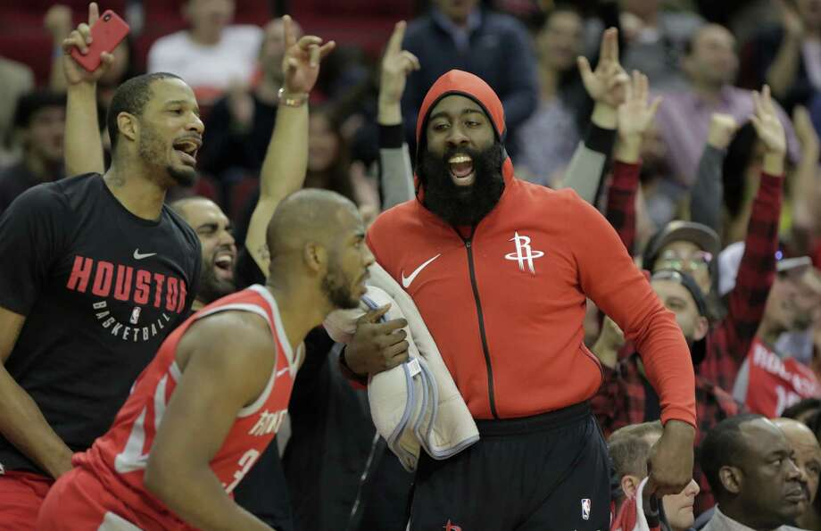 Houston Rockets guard James Harden (13) cheers with fans and his teammates after guard Chris Paul (3) sinks  a three-point-shot against San Antonio Spurs at the Toyota Center on Monday, March 12, 2018, in Houston. Photo: Elizabeth Conley, Houston Chronicle / © 2018 Houston Chronicle