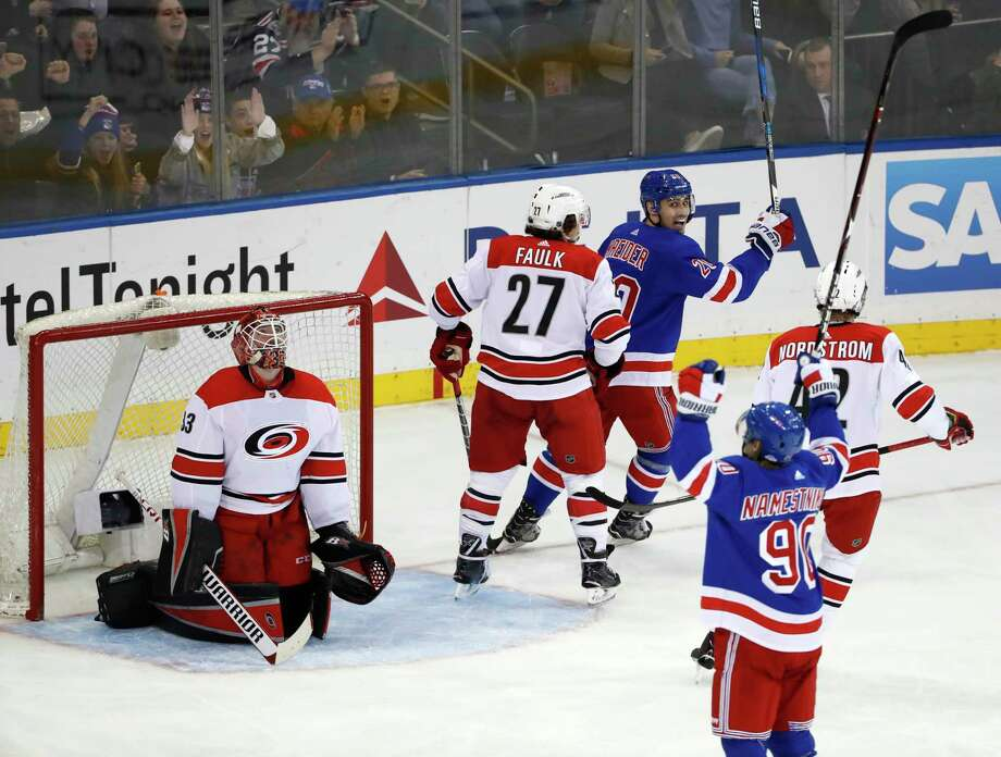 Carolina Hurricanes goaltender Scott Darling (33) reacts as New York Rangers center Vladislav Namestnikov (90), of Russia, and left wing Chris Kreider (20) celebrate Namestnikov's power play goal during the second period of an NHL hockey game in New York, Monday, March 12, 2018. Hurricanes defenseman Justin Faulk (27) and left wing Joakim Nordstrom (42), of Sweden, look on. (AP Photo/Kathy Willens) Photo: Kathy Willens / Associated Press