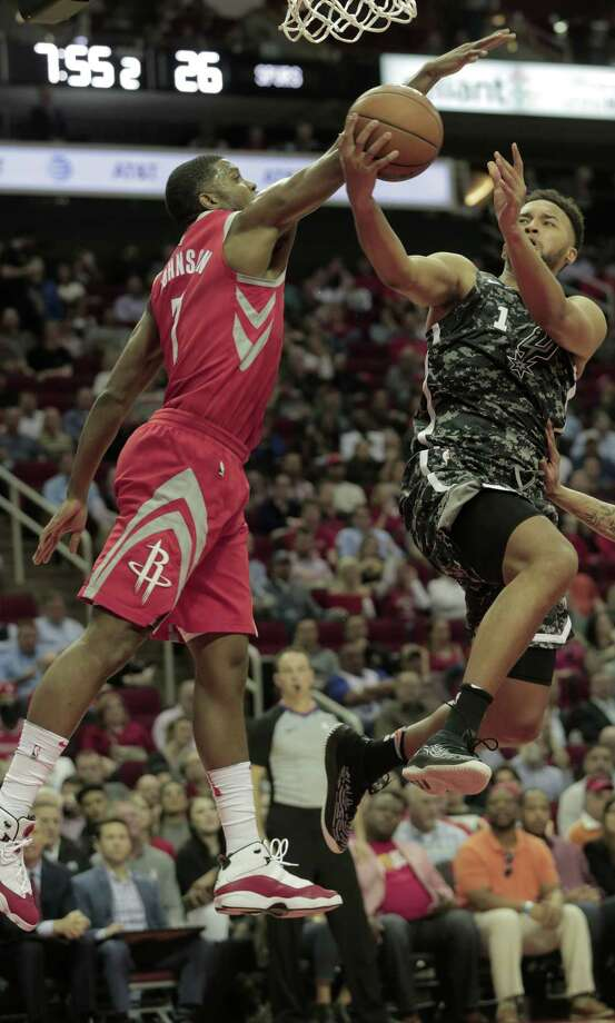 Spurs forward Kyle Anderson, right, encounters resistance from the Rockets' Joe Johnson during a first half Monday night in which San Antonio was held to 43 points. Photo: Elizabeth Conley, Staff / © 2018 Houston Chronicle
